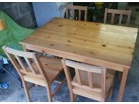 Pine table and 4 chairs. Can deliver
