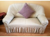2 seater and 1 seater cream faux leather sofa