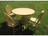 Solid pine dining room tables and four chairs