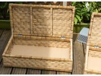 Four large rattan underbed wheeled storage boxes