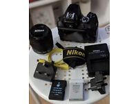Nikon D3400 DLSR with 18-55 VR lens and extra battery