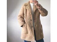 Neutral sheepskin coat