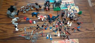 LEGO lot of Castle and Pirate Minifigures, with accessories and partial sets