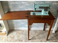 Singer Sewing Machine 348 with wooden table