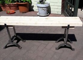 Solid wood and wrought iron bench seat