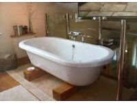 Free standing bath with chrome floor standing bath mixer taps
