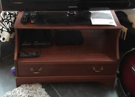 Television Stand with a drawer and one shelf for your consoles. In fairly good condition.