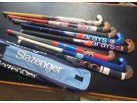 Collection of 8 used hockey sticks, with a Slazenger carry case. All well used, but good condition