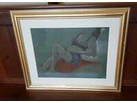 framed pastel drawing of a reclining semi clad lady, gold frame