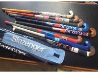 Collection of 8 used hockey sticks, with a Slazenger carry case. All well used
