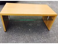 Coffee Table with glass shelving .