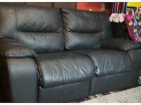 Faux leather two seater recliner