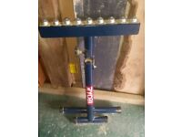 Ryobi adjustable material roller support stand.