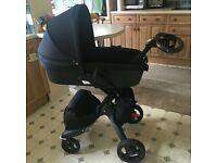 Stokke xplory true black limited addition. Includes pram, stroller, umbrella, rain cover and bag.