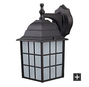 1 Colton outdoor light with frosted glass new from Home Depot