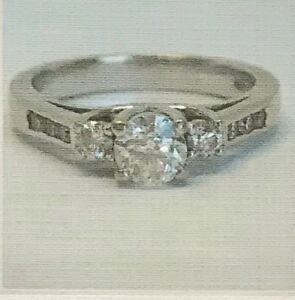 14K White Gold, Three Stones plus Channel Engagement Ring
