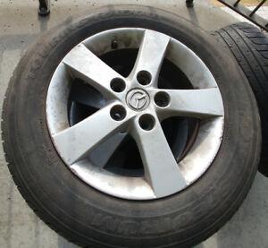 4 mazda 3 used tires and 3 Mags-(195/65/15)
