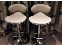 Two breakfast bar stool. Gas adjustable height