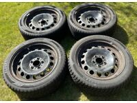 """Four 17"""" steel wheels with winter tyres including 17"""" BMW wheel trims."""