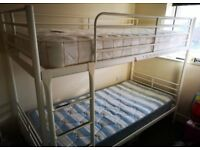 White IKEA bunk bed with mattresses