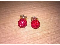 Red Swarovski stud earrings