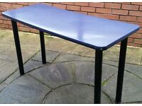 Small blue desk or table 120cm x 50cm x 73cm high. In used condition.