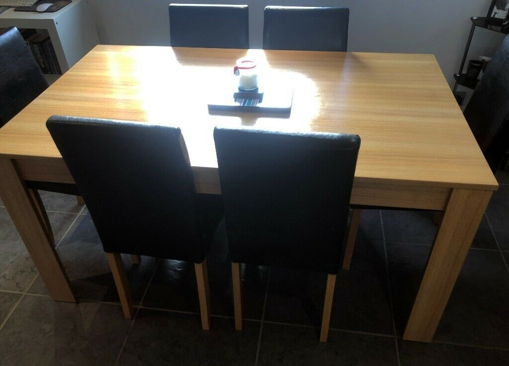 986aedce0d Oak effect dining table and 6 black faux leather chairs - Excellent  Condition!