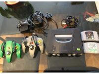 Nintendo N64 w/ conrollers and games - NTSC USA version, works!