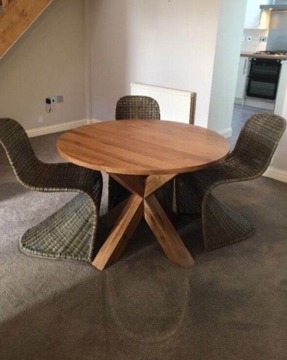 Solid oak round dining table part of the Hudson range from next