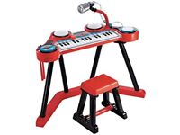 Keyboard, drums and microphone tot