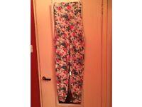 Womans floral jumpsuit size 8