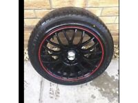 Set of black and red alloy wheels