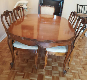 Large solid table and 8 chairs