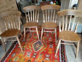 4 vintage wooden kitchen chairs with rustic charm