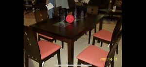 Leon's table and 6 dining chairs (2 chairs need repairs)