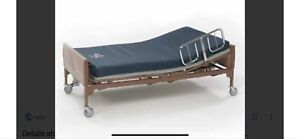Hospital bed with table