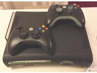 XBox 360 with 6 games and 2 controllers