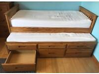 Single bed with pull out guest bed and storage