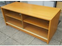 wooden tv / media table. 118 x 50 x 50cm. Two adjustable shelves. Good quality. In clean condition.