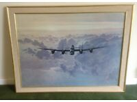 Gerald Coulson framed print , Outward bound Lancaster bomber crossing the East Coast .