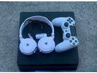 PS4 slim with white controller and headset