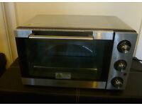 mini oven used once still looks like new