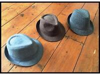 Three trilby hats