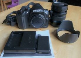 Samsung NX10 with 18-55 F3.5-F5.6 IS Lens and Hood.