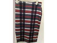 Womans size 10 papaya skirt