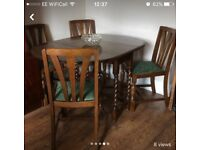 Solid oak table with 4 chairs and barley twist legs