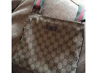 Beige genuine Gucci manbag