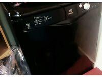 Black Indesit dishwasher
