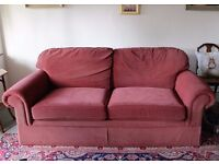 Large comfortable red/pink sofa
