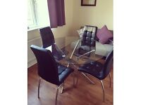 Glass table and 4 chairs ***reduced in price***